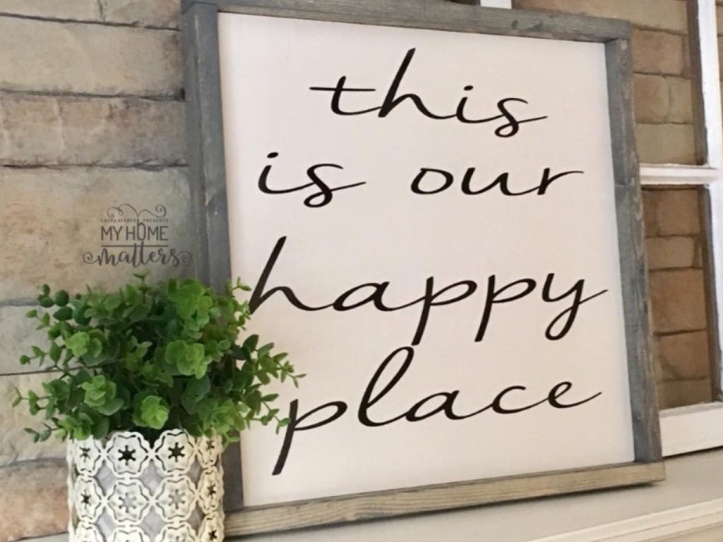 gray gel stain frame with old white background and gray lettering done in Nella Sue font